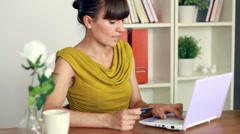 Attractive woman buying online with her laptop and credit card Stock Footage