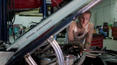 Portrait of a man working on a classic car, dolly shot Stock Footage