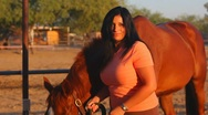 Stock Video Footage of Brunette woman and her horse close ups - 7