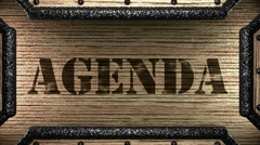 agenda on wooden stamp - stock footage