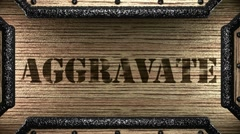 aggravate on wooden stamp - stock footage