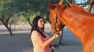 Stock Video Footage of Brunette woman and her horse - 1