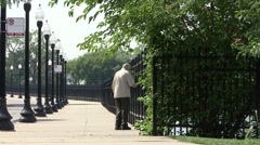 Senior man walks with cane in Chicago Stock Footage