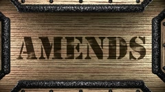 amends on wooden stamp - stock footage