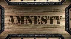 Amnesty on wooden stamp Stock Footage