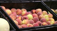 Woman Selecting Peaches In Produce Stock Footage