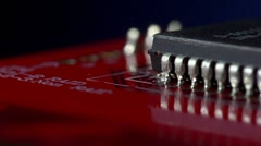 Slow flight past integrated circuit (IC) extreme shallow DOF Stock Footage