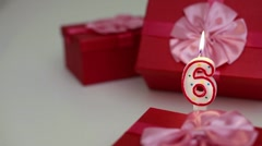 Gift boxes with number candles (6) Stock Footage