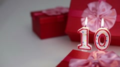 Gift boxes with number candles (10)  Stock Footage