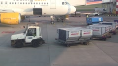 Baggage cart arrives at plane Stock Footage