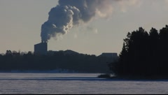 Scandinavia Finland Rauma steam smoke puthering from chimney Stock Footage
