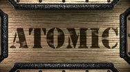 Atomic on wooden stamp Stock Footage