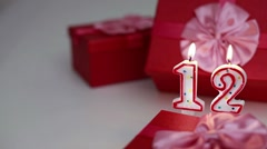 Gift boxes with number candles (12)  Stock Footage