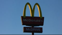 Scandinavia Finland Rauma McDonald restaurant sign flag Stock Footage