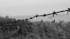 Barbed wire by the beach. Stock Footage