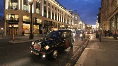 Taxi cabs in Oxford Street, London Stock Footage