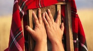 Hands hug chair Stock Footage