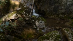 Small waterfalls with creek pan Stock Footage