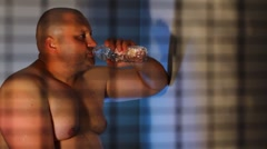 Strong men drinking fresh water Stock Footage