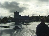 Stock Video Footage of Boat on Lakes of Killarney, Ireland, with Ross Castle in Background