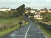 Stock Video Footage of Man with dogs on a country road, Ireland