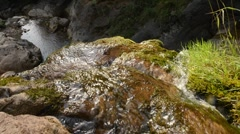 Water running down a cliff Stock Footage