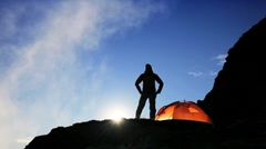 Hiker in Silhouette on Rocky Mountainside - stock footage