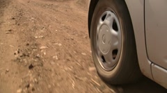 Car drving on African dirt road - stock footage