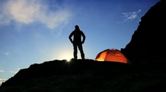 Female Hiker in Silhouette on Mountainside at Daybreak - stock footage