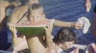 Stock Video Footage of FAMILY Eating Watermelon Lake Summertime 1960s (Vintage Film 8mm Home Movie) 507