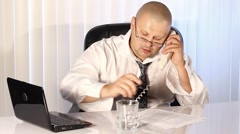 Tired Businessman talking on the phone - stock footage