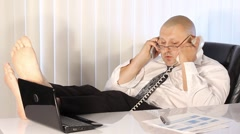 Tired Businessman talking on the phone Stock Footage