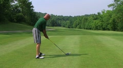Golfer Teeing Off With Driver 03 Stock Footage