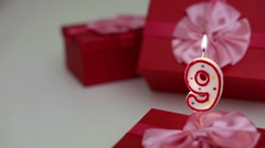 Gift boxes with number candles (9)  Stock Footage