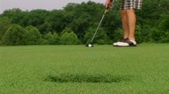 Golfer Sinks Putt 05 Stock Footage