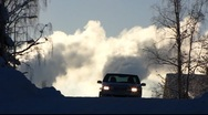 Stock Video Footage of Scandinavia Finland car auto against smokestacks belches smoke steam in sky