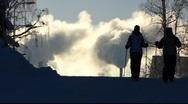 Stock Video Footage of Scandinavia Finland Nordic walker against smokestacks belches smoke steam in sky