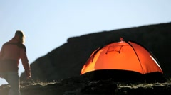 Lone Hiker Returning to Expedition Tent Stock Footage