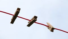 Pegs on a Clothesline - Moving in the Wind Stock Footage