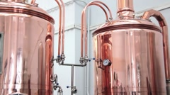Copper tuns for brewing at a brewery Stock Footage