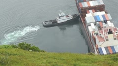 Tugboat Pushes Cargo Ship ED Stock Footage