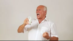 A man enjoying a glass of milk Stock Footage