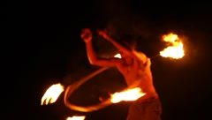 Man performing the fire show on a national holiday in Thailand Island Stock Footage