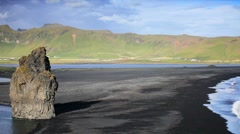 Lone Figure Watching Arctic Waves & Volcanic Ash Beach Stock Footage