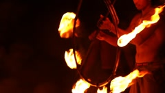 Man holding the tool of the fire show on a national holiday in Thailand Island Stock Footage
