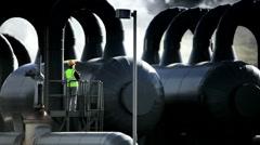 Female Geothermal Engineer Inspecting Steam Tanks - stock footage