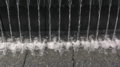 Water flows and dropps into the fountain - stock footage
