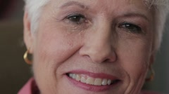 Close up shot of senior woman's face, happy Stock Footage