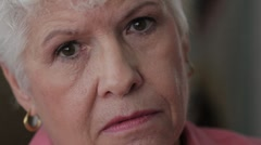 Close up shot of senior woman's face, unhappy - stock footage