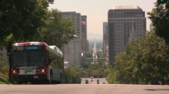 Bus and city sky scrapers Stock Footage
